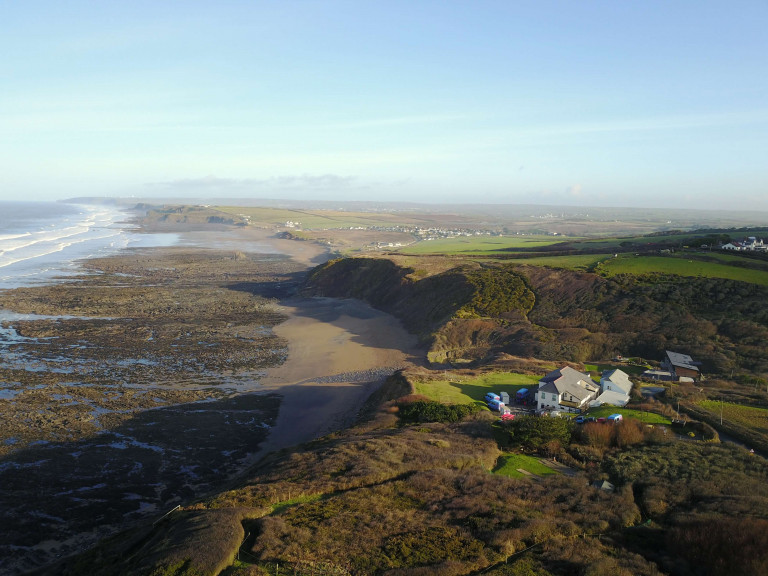 aerial view of OA Stay accommodation looking across to widemouth bay