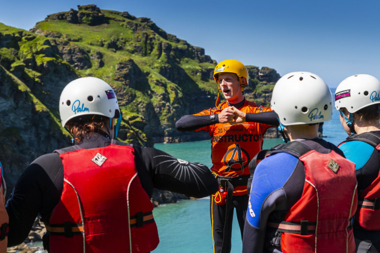 Coasteering Instructor briefing the group on safety during the coasteering session