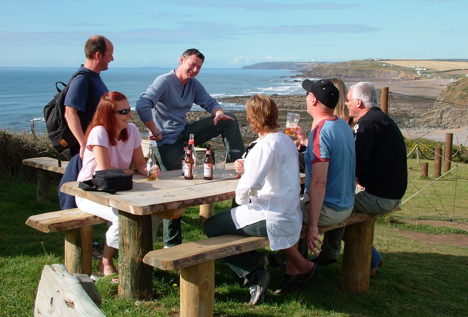 friends on cliff top at OA Stay enjoying the sunshine and the view
