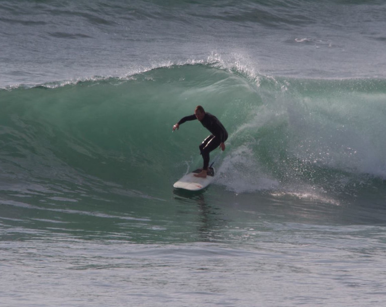 Rob Bird surfing a wave at Widemouth Bay, Bude, Cornwall