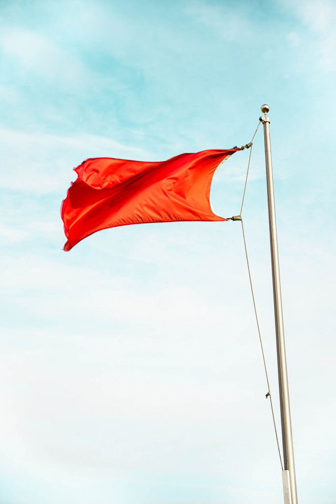 Red beach flag - Danger the sea is out of bounds
