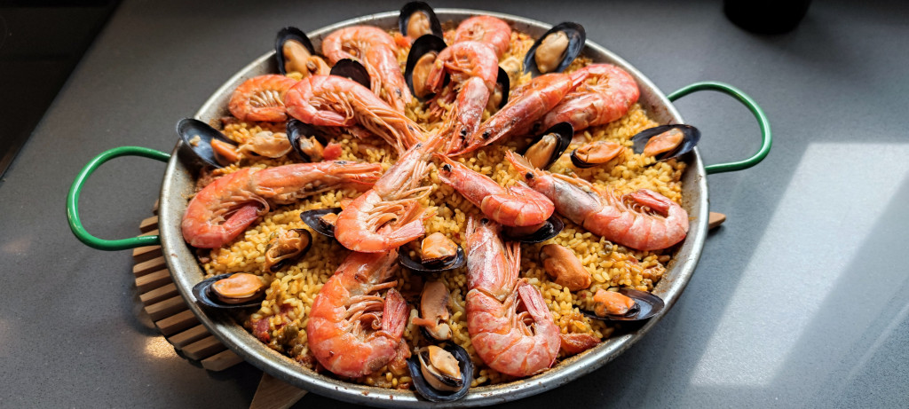 Paella dish with shrimps and muscles.