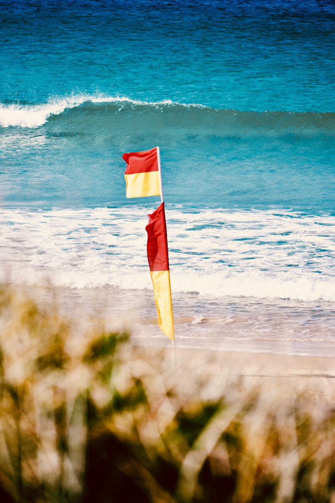 Red and yellow beach flag - safe to swim and bodyboard.
