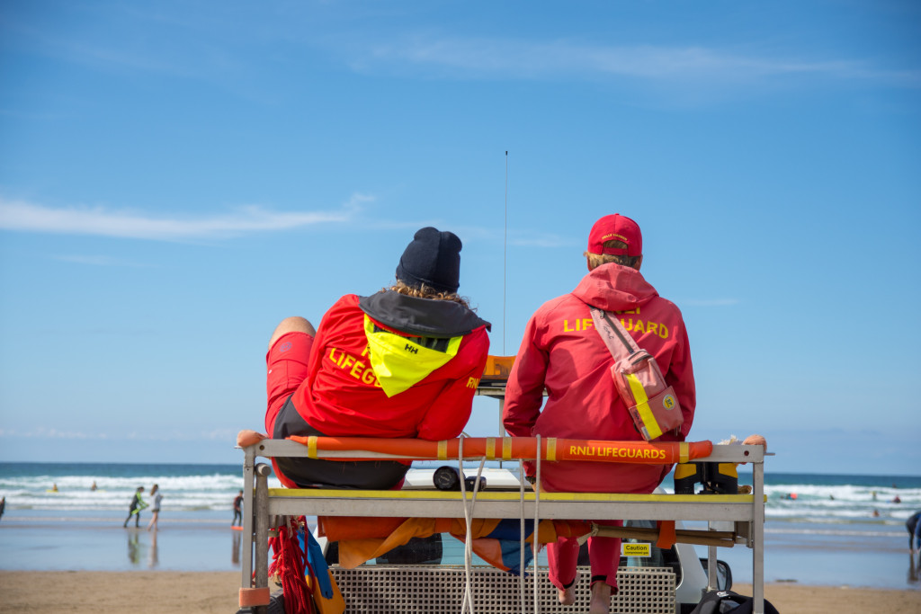 RNLI Lifeguards watching over a a busy beach.